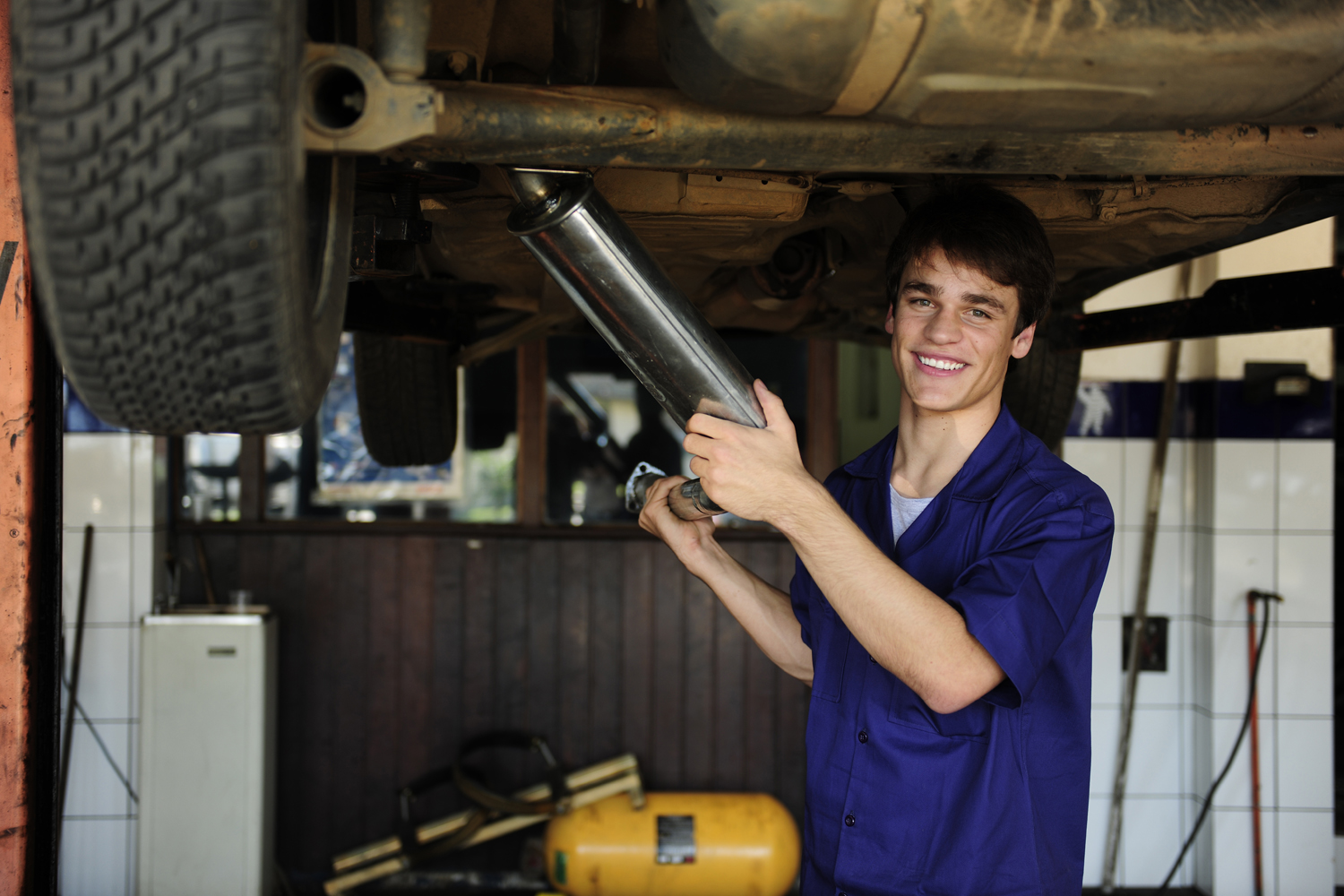 happy car mechanic at work